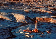 Onshore Oil Drilling Rig in Mountainous Snow Covered Terrain