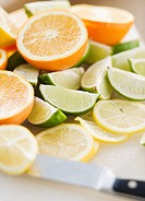 Freshly cut lemons limes and oranges