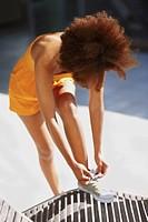 Woman tying her shoelace