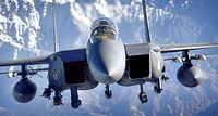 An F-15E Strike Eagle soars over the mountains of Afghanistan in support of Operation Mountain Lion April 12, 2006  The crew and fighter are deployed ...