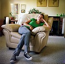 Bored Teen Girl Sitting in Easy Chair