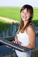 Woman with a computer keyboard in her hands