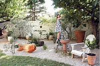 Girl standing on step ladder in garden