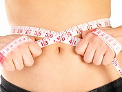 Keeping a diet and fitness rutine _ Measuring tape around a waist, woman