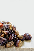 Sweet chestnuts in net