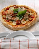 Pizza topped with pork fillet and potatoes