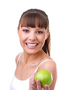 Beautiful young girl handing you a healthy looking green apple Isolated on white background