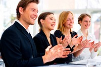 Photograph of a European_style business team applauding