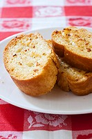 Toasted slices of garlic bread on plate