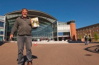 A Big Issue seller at the Forum in Norwich , Norfolk , England , Great Britain , Uk
