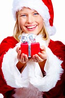 Girl giving christmas present