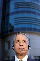 Mature man with headset (thumbnail)