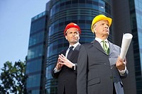 Two businessman wearing hardhats