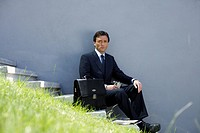 Businessman sitting on a stairway (thumbnail)