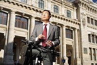 Businessman on a bike (thumbnail)