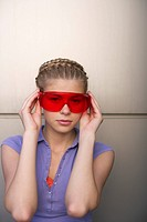 Young woman wearing red protective goggles