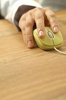 Woman's hand on computer mouse (thumbnail)
