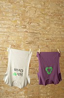 Two t_shirts hanging on clothesline