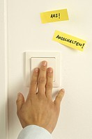 Woman pressing light switch