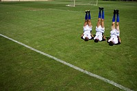 Soccer players exercising