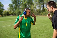 Referee piping, Brazilian soccer player wearing ear cups