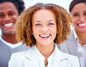 Closeup portrait of a smiling business woman with executives against white background