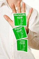 Man showing three symbols for waste separation, Germany