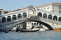 Gondola drivers under Rialto bridge, Venice, Italy