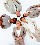 Portrait of happy business people lying on white background