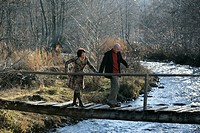 Mature couple walking over a bridge