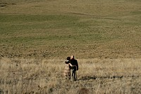 Man and woman standing on a field (thumbnail)