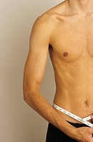 Man measuring his Waistline - Vanity - Physicalness - Exactness (thumbnail)