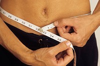 Man measuring his Waistline _ Vanity _ Physicalness _ Exactness