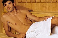 Darkhaired Man with a Towel around his Taille _ Heat _ Sauna _ Wellness