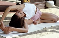 Darkhaired Woman doing a Physical Exercise _ Stretching _ Yoga _ Physicalness