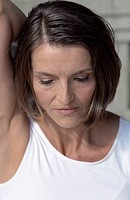 Darkhaired Woman stretching her Arm backwards _ Stretching