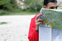 Man is studying a map