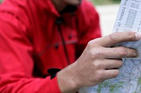 Mountaineer reading a map