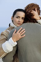 Darkhaired Woman hugging an auburn haired Man _ Relationship _ Emotion _ Togetherness