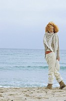 Woman with a strawberry blonde curly Head strolling along the Beach _ Lonliness _ Season _ Nature