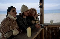 Three Friends at a Beach_Bar _ Winterly Clothing _ Season _ Nature