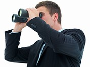 Closeup of a young business man looking through binocular isolated on white background