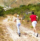 Rear view of a young couple practicing their run out in the wilderness