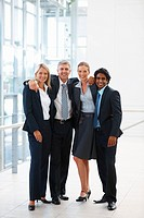 Happy group of business people standing together at the hallway