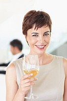 Portrait of beautiful business woman holding a glass