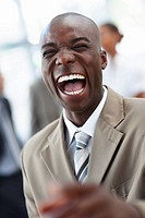 A laughing cheerful African American business man