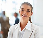 Image of a confident smiling business woman with people at the back