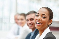 Closeup image of a laughing African American business woman at a conference