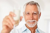 Portrait of a happy mature man holding a glass of champagne