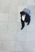 Top view blurred image of a business man walking with his luggage